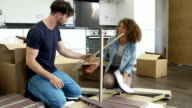 Frustrated Couple Putting Together Self Assembly Furniture video