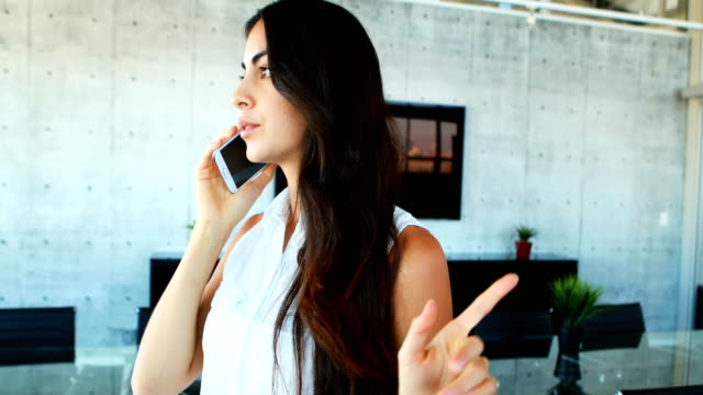 Frustrated female executive talking on mobile phone 4k video