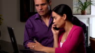 Frustrated Latin Couple Argue with Company over the Phone video