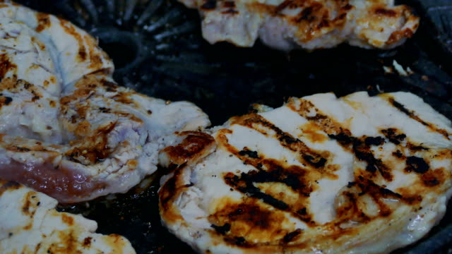 Fry steak meat. closeup. pork in a frying pan video