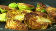 Frying Brussels sprouts macro shot video