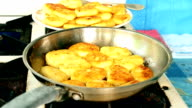 Frying cottage cheese pancakes on gas stove video
