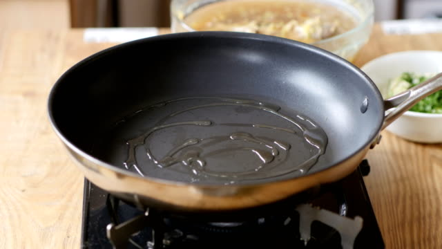 frying leek for making risotto video