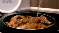 Frying meat in a pan on an electric stove video