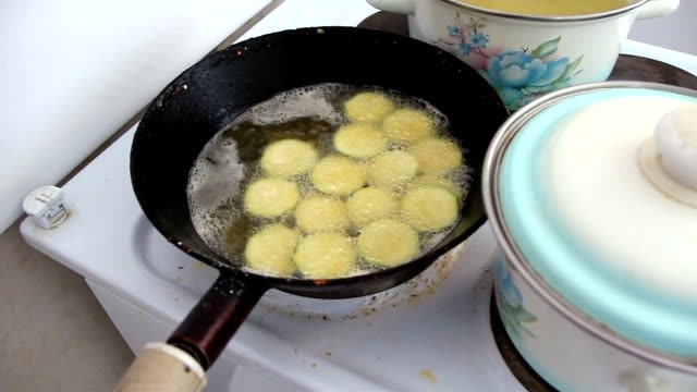 Frying pan with vegetable marrows in sunflower oil video