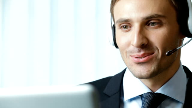 Full HD 1080p: Customer support phone operator at workplace, working video