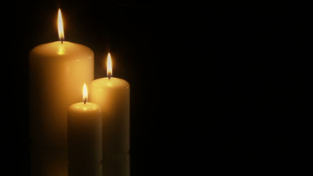Full HD Three Candles On Black Background - PAL 25fps video