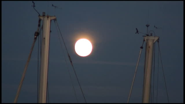 (HD1080) Full Moon Between Boat Masts video