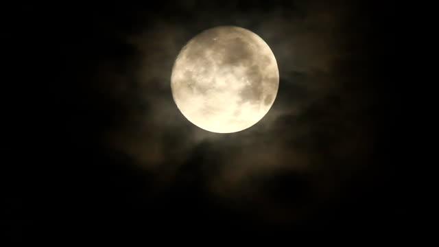 Full moon in rain cloud video