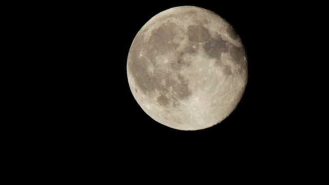 Full moon moving in the night sky video