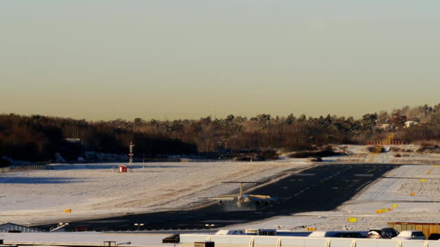 FullHD footage airplane landing in winter airport, dawn sunrise time video