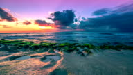 FullHD Timelapse. Sunset in the Indian Ocean on the Balangan beach volcanic bowls. 15 July 2015, Bali, Indonesia video