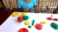 Fun little girl with play dough modelling clay for kids video