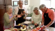 SLOW MOTION - Fun Mature Preparing Food in Kitchen. video