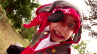 Fun Pirate boy playfully fighting with his saber in park video