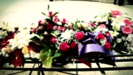 HD: Funeral Wreaths on A Hearse video