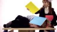 Funny boy lying at school desk video