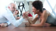 Funny businessman and woman arm wrestling video