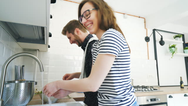Funny couple preparing food together. video