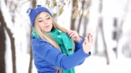 Funny girl make selfie in snowy forest video
