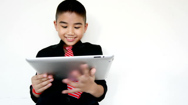 Funny Little Boy Using Digital Tablet And Laptop video