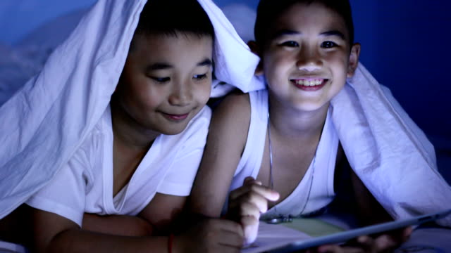 Funny Little Boy Using Digital Tablet video