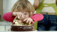 HD: Funny Little Girl Devouring A Cake video
