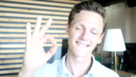 funny looking guy showing OK sign video