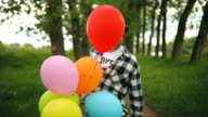 Funny male nerd playing with balloons video