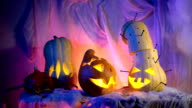 Funny pumpkin head the company during the night Halloween. sinister composition but lovely holiday attributes video
