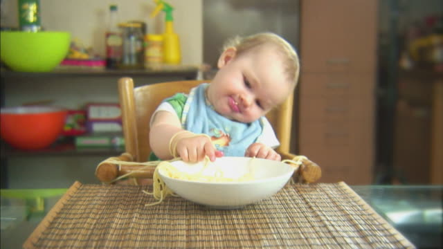 Funny scene with spaghetti & baby. Feel the rhythm. HD video