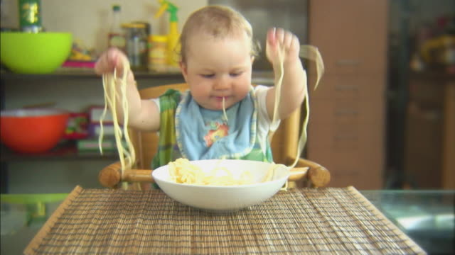 Funny scene with spaghetti & baby. Swing that noodle. HD. video