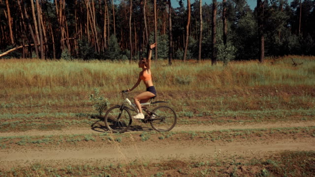 funny young woman driving a Bicycle video