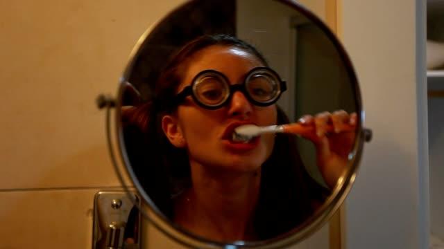 Funny young women brushing teeth video