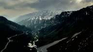 Furkapass mountain road dark scene and stormy weather time lapse video
