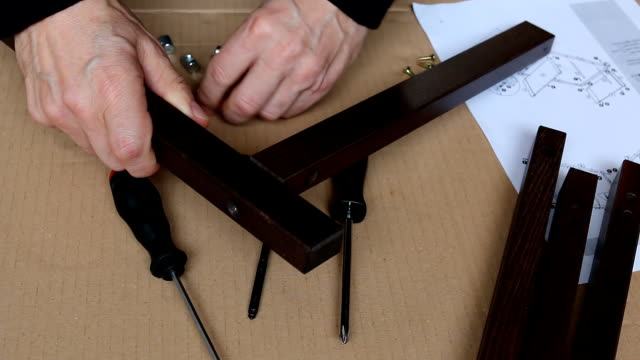 Furniture assembly from drawing video