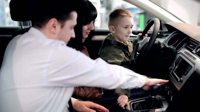Future driver testing vehicle in dealership. video