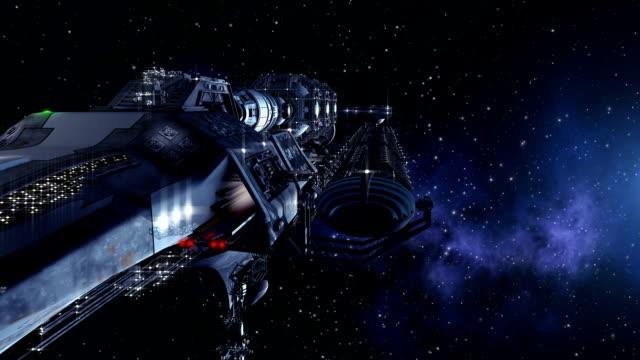 Futuristic spacelab or alien military spacecraft in deep space video