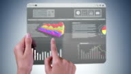 Futuristic tablet with financial data. video