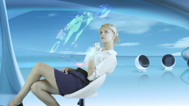 Futuristic Touch Screen. Businesswoman working. video