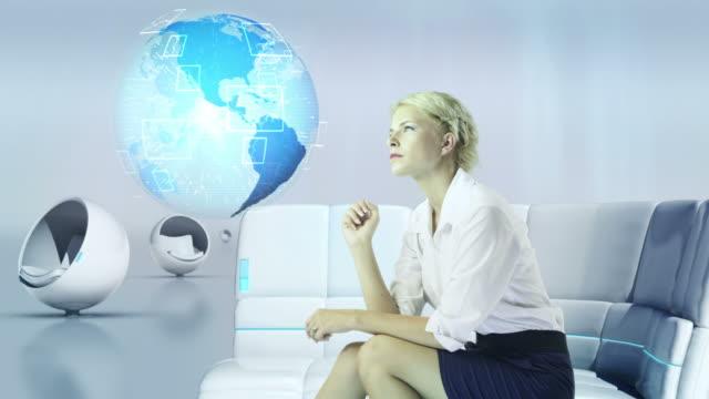 Futuristic Touch Screen. Businesswoman working. video
