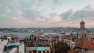 Galata bridge in Istanbul and the Bosphorus at sunset ship traffic video