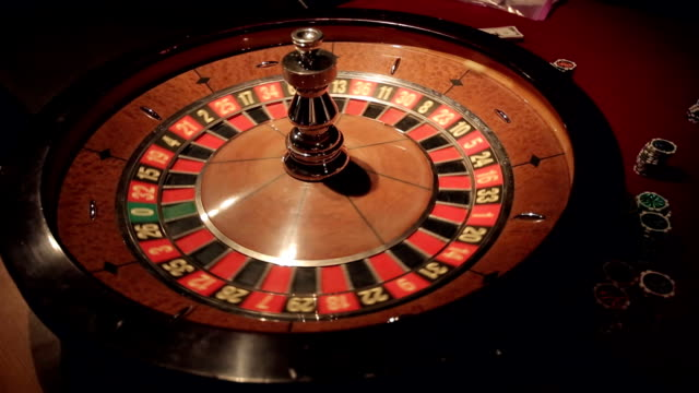 Gambling casino roulette spinning ball lands on number 11 video