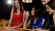 gambling girl in a blue dress playing in a casino. video