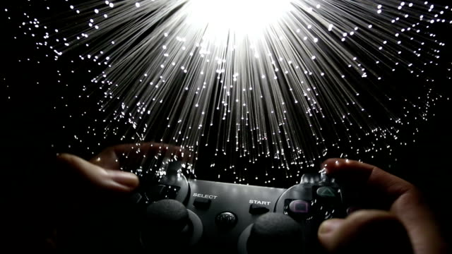 Game controller  with Fiber optics background, shot in HD video