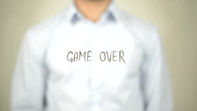 Game Over , Man writing on transparent screen video