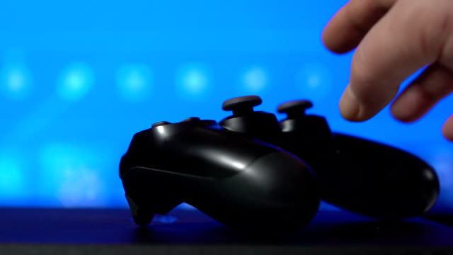 Gamer playing game on video gaming console with wireless controller video