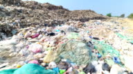 Garbage at a rubbish dump in a landfill site, pollution, Global warming video