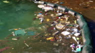 Garbage floats in the sea near the coast. Abuse of environment video