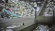CS SLO MO Garbage on the conveyor belt of a recycling facility video